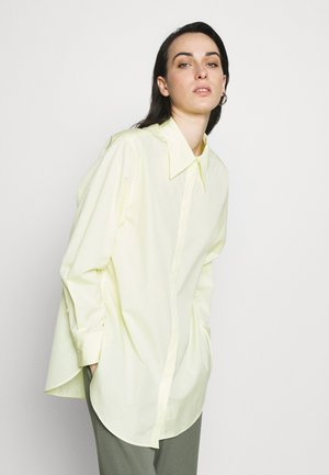 EXAGGERATED COLLAR TOP - Button-down blouse - pale yellow