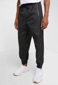 3.1 Phillip Lim - OFFSET ZIPPER TRACK PANT - Kalhoty - black - 0