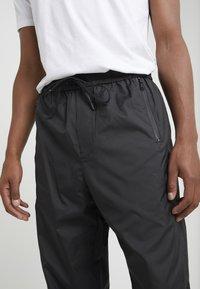 3.1 Phillip Lim - OFFSET ZIPPER TRACK PANT - Kalhoty - black - 4