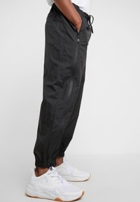3.1 Phillip Lim - OFFSET ZIPPER TRACK PANT - Kalhoty - black - 3