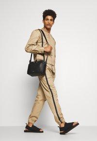 3.1 Phillip Lim - CLASSIC TRACK PANT SIDE TAPES - Pantalones - sand - 1