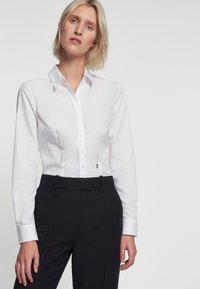 Seidensticker - SCHWARZE ROSE - Button-down blouse - white - 0