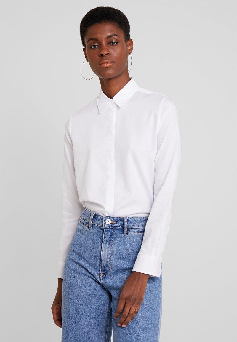 Seidensticker - WASHER FASHION - Button-down blouse - optical white