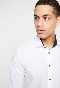 Seidensticker - BUSINESS KENT EXTRA SLIM FIT - Formal shirt - white - 3