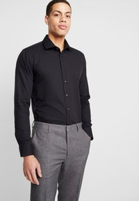 Seidensticker - BUSINESS KENT EXTRA SLIM FIT - Formal shirt - black - 0