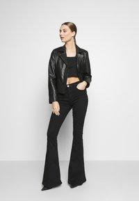 3x1 - MAXIME - Bootcut jeans - black denim - 1