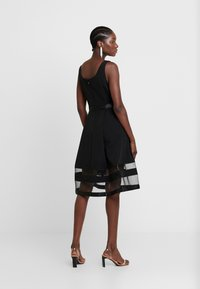 Apart - DRESS WITH ORGANZA - Sukienka koktajlowa - black - 3