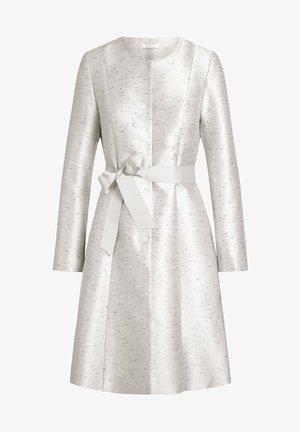 Manteau classique - creme-schwarz