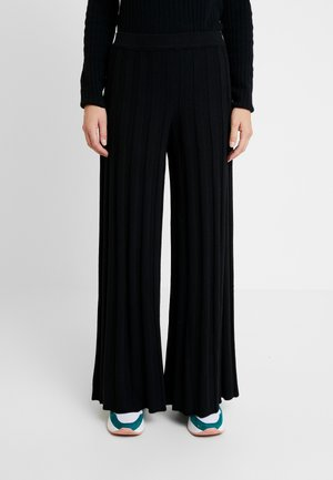 KICK FLARED TROUSERS - Pantalones - black