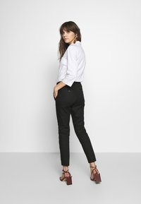 Benetton - TROUSERS - Chinot - black - 2