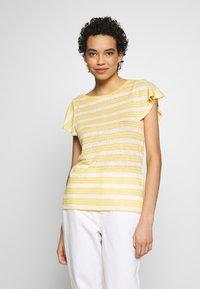 Benetton - T-shirt con stampa - yellow - 0