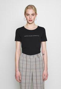 Benetton - T-shirt z nadrukiem - black - 0