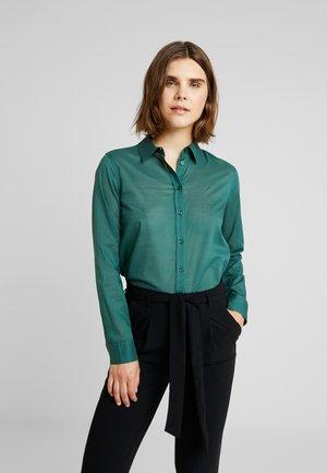 BUSINESS BLOUSE - Button-down blouse - dark green