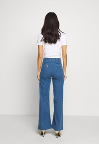 Benetton - TROUSERS - Flared jeans - mid blue - 2