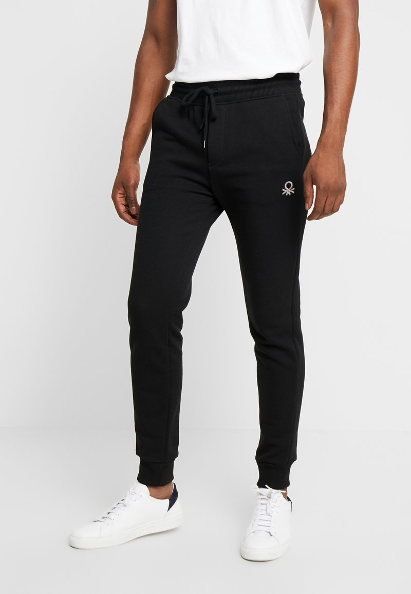 Benetton - Jogginghose - black