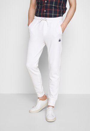 TROUSERS - Teplákové kalhoty - white