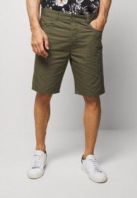 Benetton - BASIC CHINO - Shorts - military green - 0