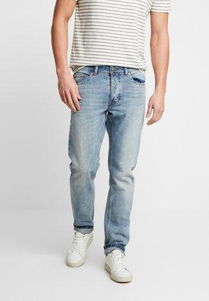 Jeans a sigaretta - washed light denim