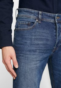 Benetton - SLIM ROLLED UP - Jeans slim fit - dark blue demin - 3