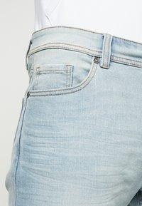 Benetton - SLIM ROLLED UP - Jeans slim fit - washed light denim - 5