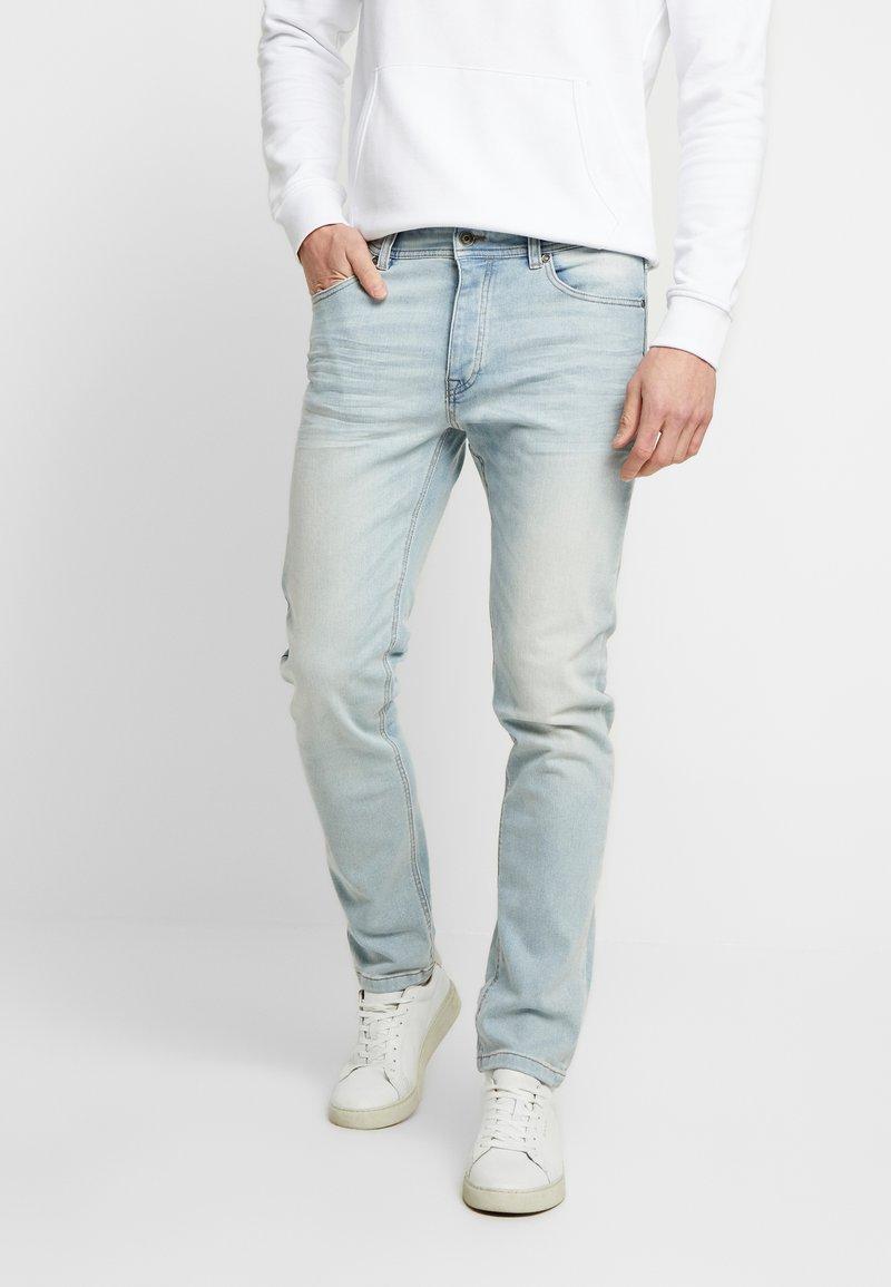 Benetton - SLIM ROLLED UP - Jeans slim fit - washed light denim