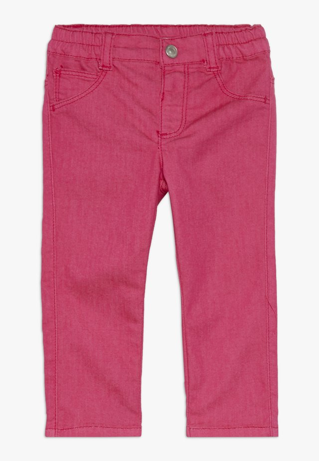TROUSERS - Slim fit jeans - pink