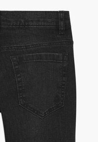 Benetton - BASIC BOY - Slim fit jeans - black denim - 2