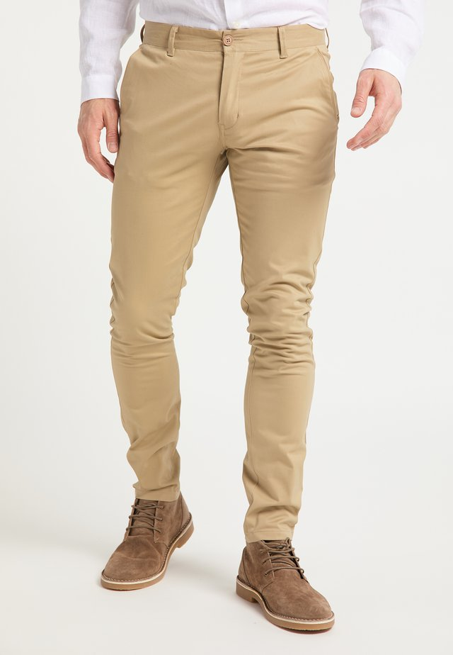 Pantalones chinos - hellsand