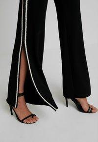 Forever Unique - NANO - Trousers - black - 4