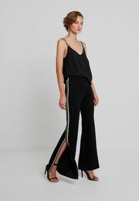 Forever Unique - NANO - Trousers - black - 2
