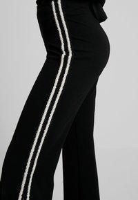 Forever Unique - NANO - Trousers - black - 6