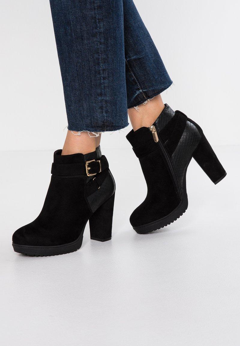 H.I.S - Kotníková obuv na vysokém podpatku - black
