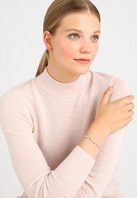 Swarovski - TENNIS BRACELET  - Bracelet - rosegold-coloured - 1