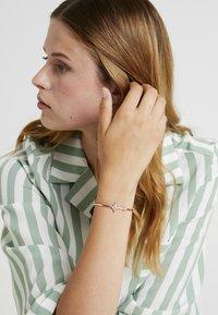 Swarovski - SYMBOL BANGLE  - Armband - rosegold-coloured - 1