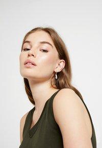 Swarovski - NAUGHTY HOOP DROP  - Earrings - rosegold-coloured - 1