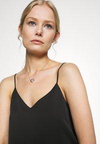 Swarovski - INFINITY NECKLACE - Necklace - crystal - 1