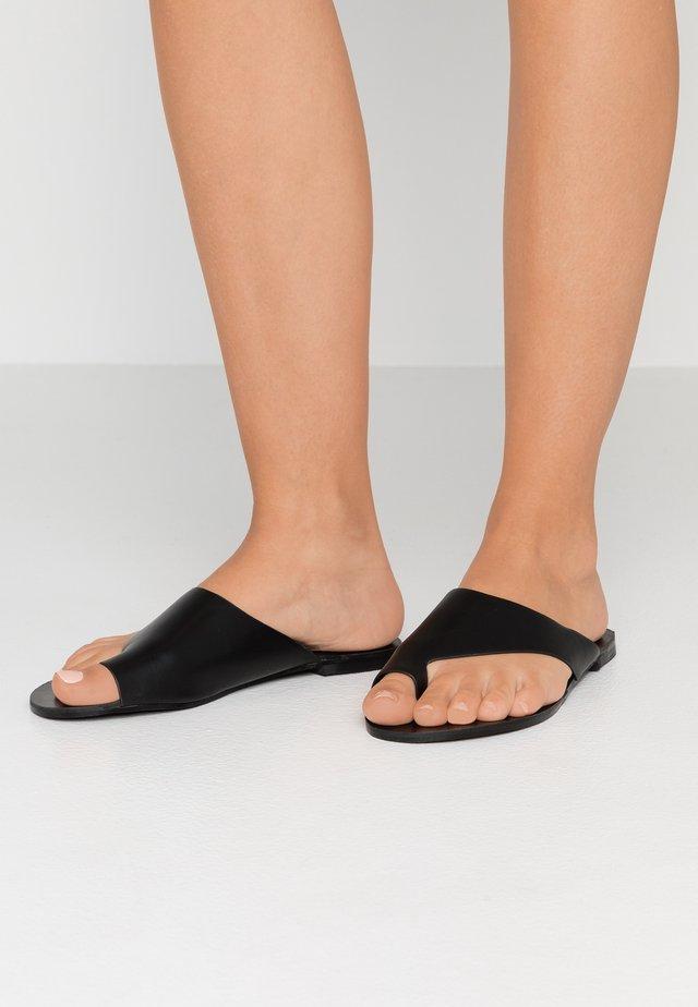 ROBERTS - T-bar sandals - black