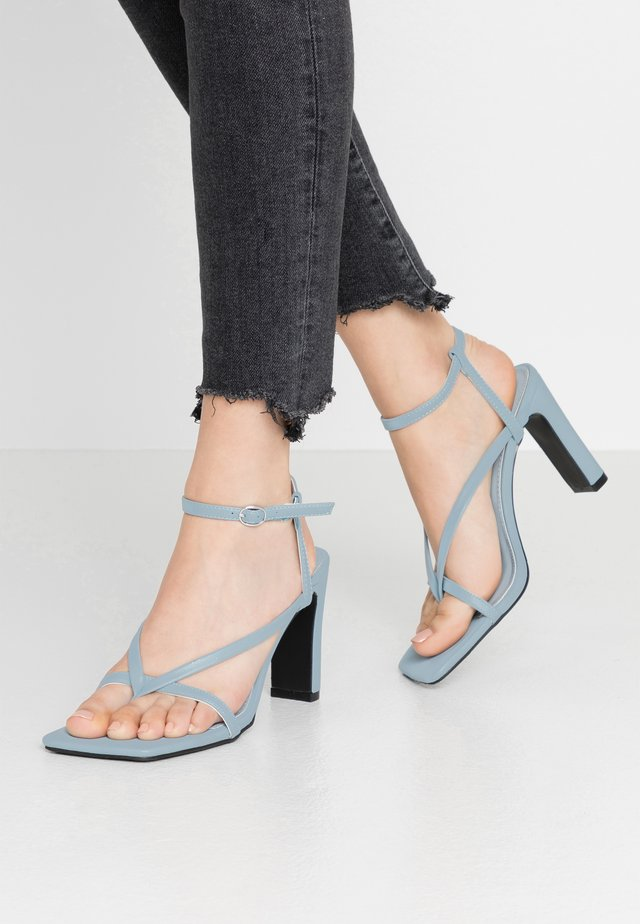 MURPHY - Korolliset sandaalit - baby blue