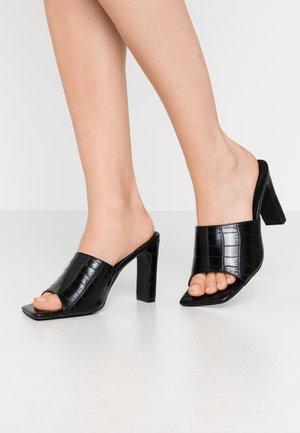 ARLO - Heeled mules - black