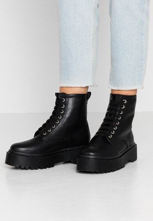 AUSTIN - Platform ankle boots - black