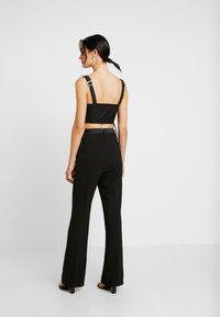 4th & Reckless - MELODY TROUSER - Trousers - black structured - 2