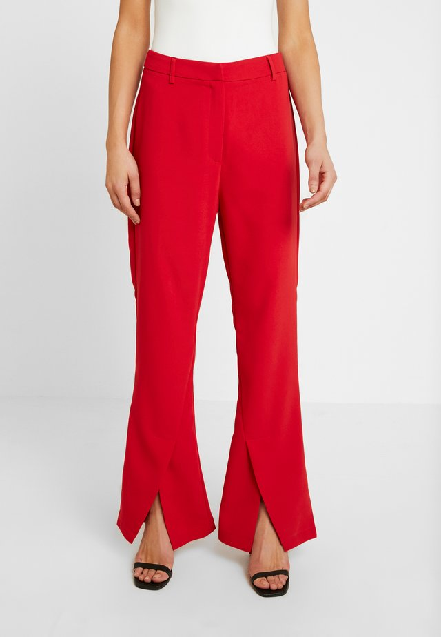 DION TROUSER - Tygbyxor - red