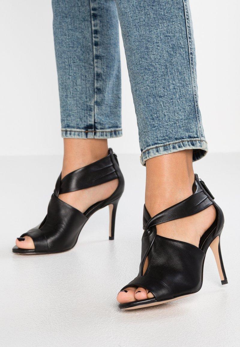 Bibi Lou - High heeled sandals - black