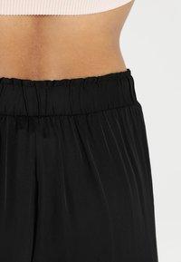 Deha - YOGA PANTS - Tracksuit bottoms - black - 5