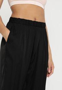 Deha - YOGA PANTS - Tracksuit bottoms - black - 3