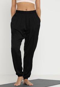 Deha - YOGA PANTS - Tracksuit bottoms - black - 0