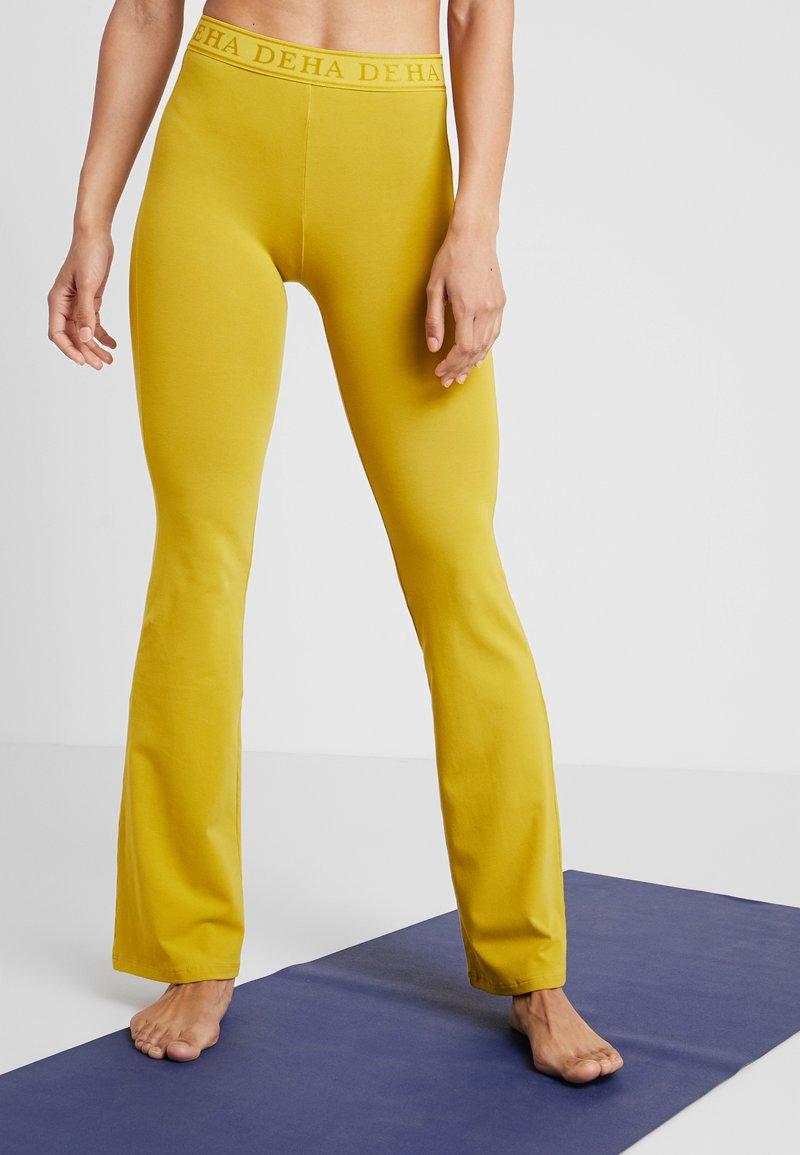 Deha - PANTA JAZZ - Tracksuit bottoms - golden lime