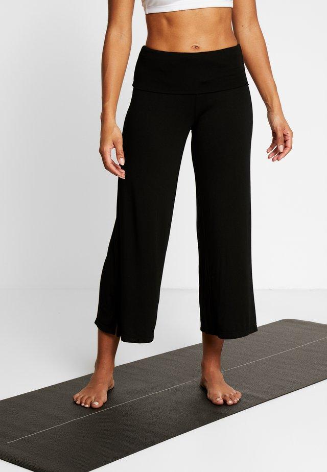 PANTALONE PALAZZO - Spodnie treningowe - black