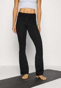 Deha - JAZZ PANTS - Pantalones deportivos - black - 0