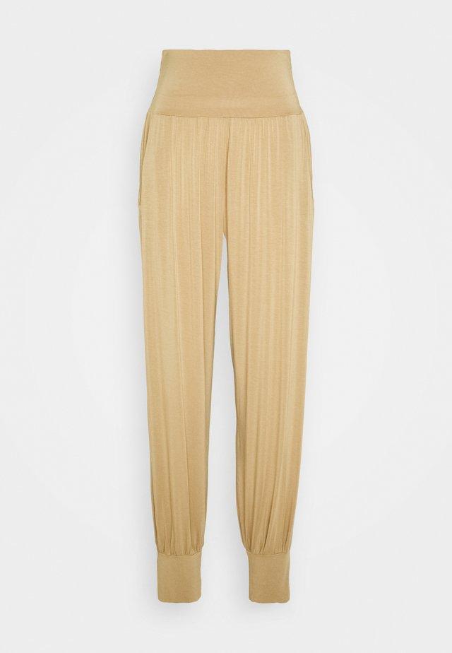 PANTS - Tracksuit bottoms - beige